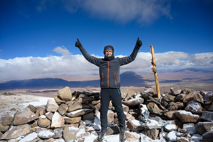 moški na vrhu vulkana Uturunku